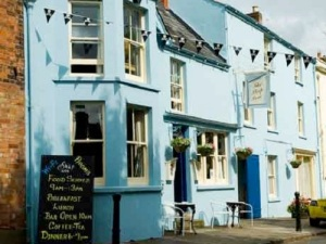 The blue exterior of the cosy Ship Inn, Newnham-on-Severn